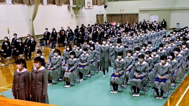 stockvideo's en b-roll-footage met video footage taken on feb 29 at st mary's girls' high school in gifu shows this year's graduation ceremony held with precautions against the spread... - slagen school