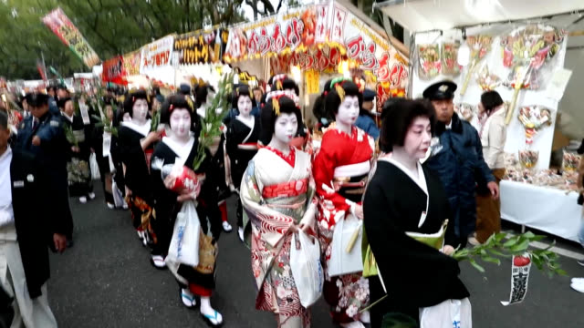 video footage taken on jan 9 shows a coterie of geisha female entertainers attired in elaborate kimono and with rice stalks as hairpins walking at... - performer点の映像素材/bロール