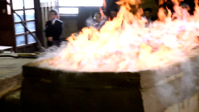 """video footage taken on january 24japan in okuizumo shimane prefecture shows men working to feed coal and iron sand into a """"tatara"""" clay furnace at is... - 鋼点の映像素材/bロール"""