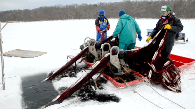 video footage taken on januarya 15japan on frozen lake abashiri in hokkaido shows members of a local fishing cooperative winching up a net filled... - catch of fish stock videos & royalty-free footage