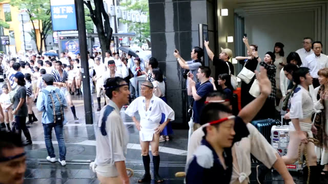 video footage taken on july 10 in fukuoka shows revelers in traditional festival attire gathering together to pull an ornately decorated float... - annual event stock videos and b-roll footage