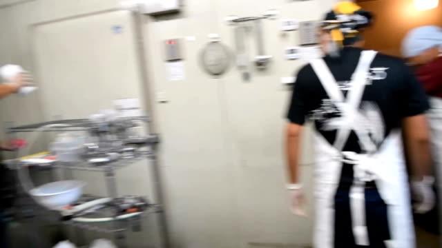 video footage taken on july 18 in kurashiki okayama prefecture shows members of okayama mind kokoro scrubbing and cleaning the equipment at its beer... - scrubbing up stock videos and b-roll footage
