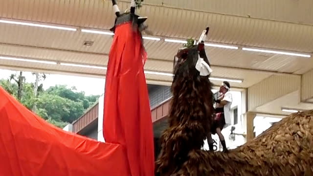 """Video footage taken on July 24 in Uwajima Ehime Prefecture shows dozens of men butting two immense """"ushioni"""" demon bull floats against each other on..."""