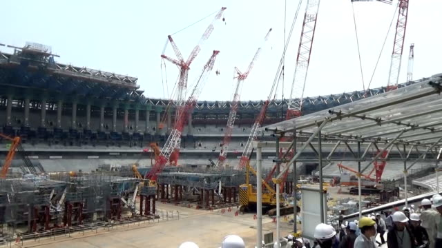 stockvideo's en b-roll-footage met video footage taken on july 24 shows the new national stadium straddling shibuya and shinjuku wards under construction to serve as the main venue for... - benen gespreid