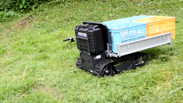 video footage taken on july 9 at a wakayama prefecturerun plum research center in minabe shows a demonstration of a remotely operated grass mower... - 減少点の映像素材/bロール