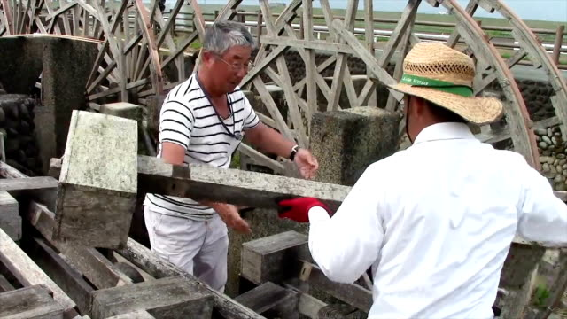 video footage taken on june 10 in asakura fukuoka prefecture shows carpenters preparing and strengthening a historic triple irrigation waterwheel... - water wheel stock videos and b-roll footage