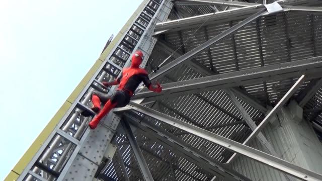video footage taken on june 20 in osaka's shinsekai district shows a stuntman dressed as spider-man scaling the area's landmark tsutenkaku tower. the... - stunt person stock videos & royalty-free footage