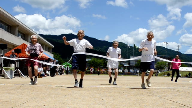 Video footage taken on June 4 Japan in sabae Fukui Prefecture shows four elderly brothers not exactly fleetfooted crossing the finish line together...