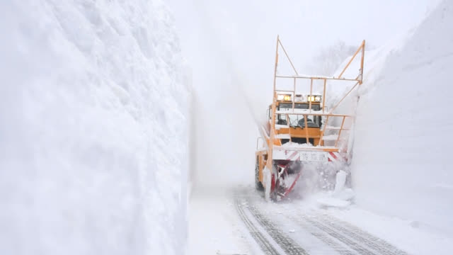 video footage taken on march 12 in aomori prefecture shows a large snowclearing vehicle carving deep snow off an 8kilometer section of national route... - aomori prefecture stock videos & royalty-free footage