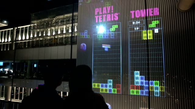 Video footage taken on Nov 30 shows children playing the computer game Tetris Tower projected to a height of 12 meters on walls on the top floor of...