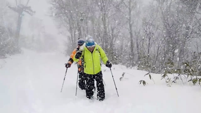 video footage taken on november 212018 in sapporo japan shows yuichiro miura training with skis on mount teine in sapporo for a planned expedition to... - 高い点の映像素材/bロール