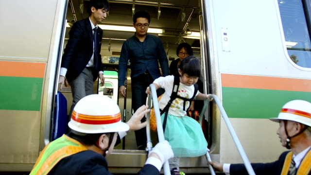Video footage taken on Oct 23 shows passengers of an East Japan Railway Co train bound for Tokyo having to make an unexpected transfer after being...