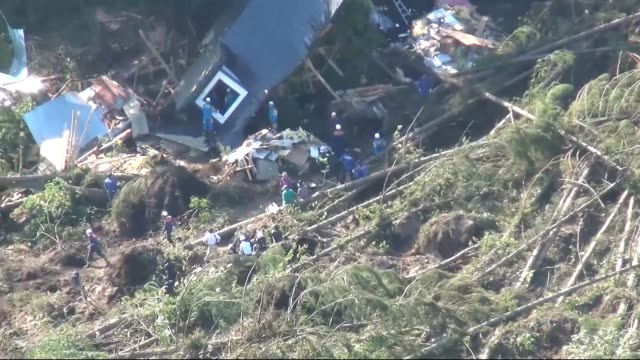 vídeos de stock, filmes e b-roll de video footage taken on sept 6 shows rescuers searching through homes and other structures in the yoshino district of atsuma in hokkaido after a... - terremoto