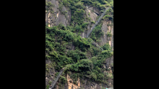 video footage taken on sept 7 in the liangshan yi autonomous prefecture of china shows visitors scaling a ladder fashioned from steel pipes leading... - ハシゴ点の映像素材/bロール