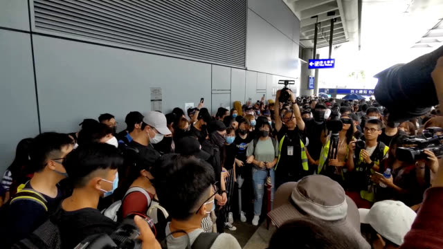 video footage taken on the afternoon of sept 1 shows a gathering of protestors block entrances to the city's international airport a day after... - 抗議者点の映像素材/bロール
