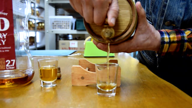video footage taken shows osakabased importer shunichi maruyama showing off his inventory of miniature wooden barrels made for aging whiskey shochu... - bar drink establishment stock videos & royalty-free footage