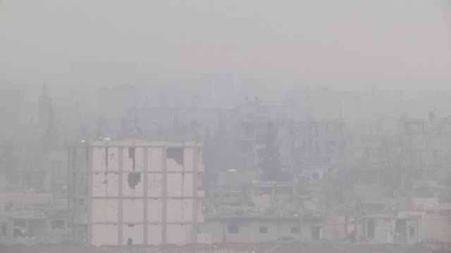 a video footaged from suruc district of sanliurfa southeastern province of turkey shows smoke rises during the clashes between the islamic state of... - isil konflikt stock-videos und b-roll-filmmaterial