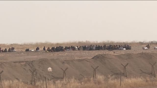 A video footaged from Turkey's southeastern city Sanliurfa shows a group of Syrians fled from clashes and try to cross Syrian Turkish border in...