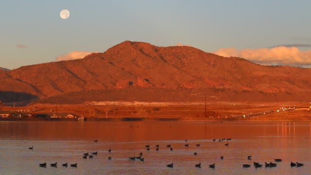 hd video full moon duck lake sunrise mount morrison colorado - red rocks stock videos and b-roll footage