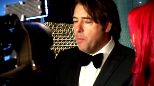 video game awards: arrivals; jonathan ross and wife jane goldman arriving and posing for press int ross and wife being interviewed by television crew... - television game show stock videos & royalty-free footage