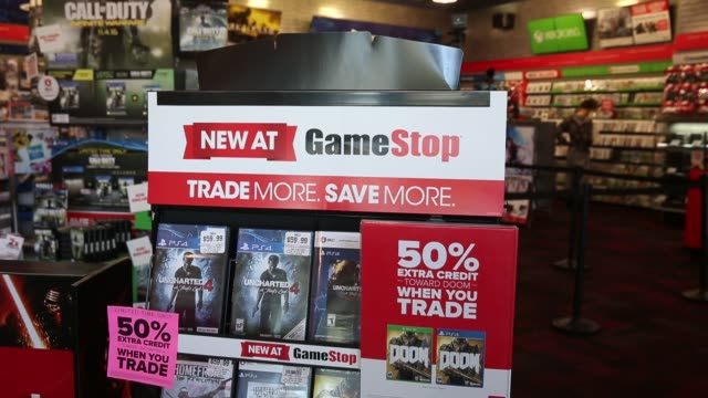 Video games are displayed for sale inside the GameStop Corp Store in West Hollywood California US on Sunday May 22 2016 Shots pan right of...