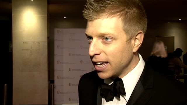 British Academy Games Awards 2013 Jeffrey Yohalem interview SOT / partly obscured shot of Mark Wright signing autographs / Louis Smith speaking to...