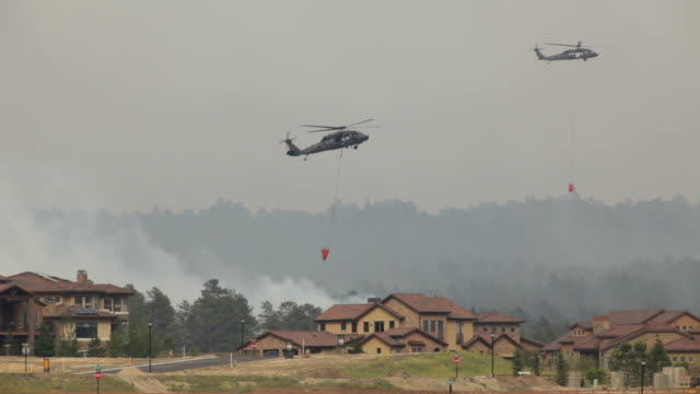 HD video Helicopters water drop on Colorado Springs wildfire