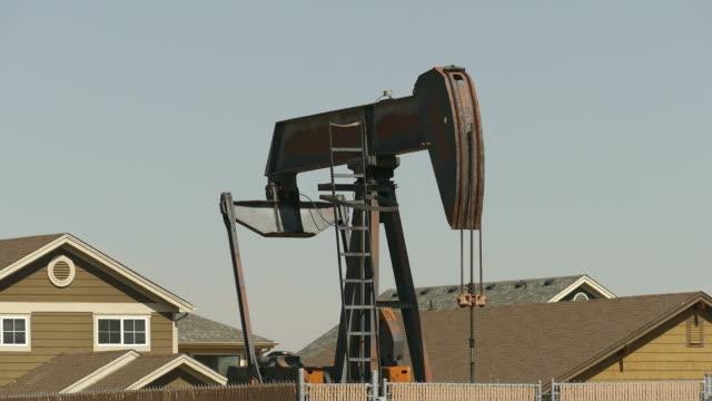 hd video homes surround oil well pad pump jack frederick colorado - colorado stock videos & royalty-free footage