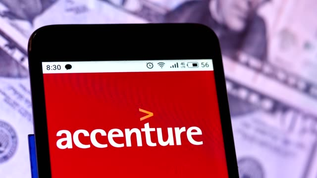 video illustration the logo of accenture limited is displayed on a smartphone rotating at different denominations dollar bills video taken in kiev,... - financial accessory stock videos & royalty-free footage