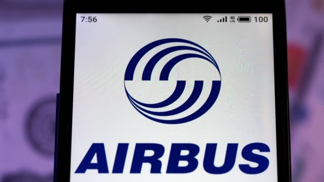 video illustration the logo of airbus is displayed on a smartphone in hands counting 100 dollar bills video taken in kiev, ukraine, on september... - intellectual property stock videos & royalty-free footage