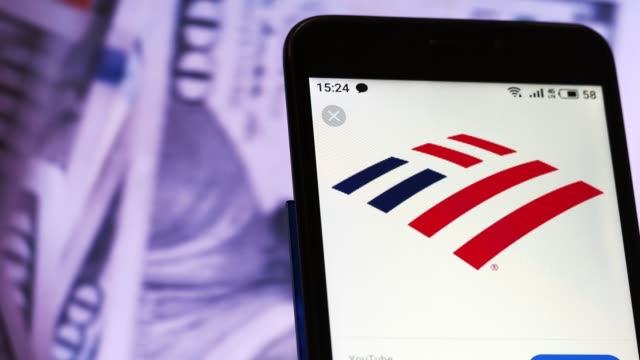 video illustration the logo of bank of america is displayed on a smartphone in hands counting 100 dollar bills video taken in kiev ukraine on tuesday... - bank of america stock videos and b-roll footage