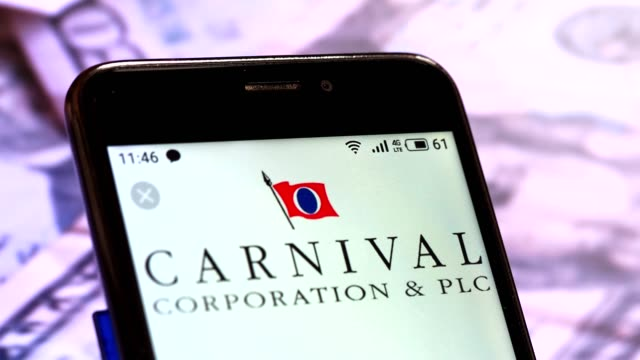 video illustration the logo of carnival corporation & plc is displayed on a smartphone rotating at different denominations dollar bills video taken... - plc stock videos & royalty-free footage