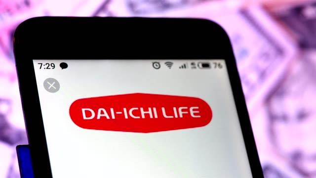 video illustration the logo of dai-ichi life holdings is displayed on a smartphone rotating different denominations dollar bills video taken in kiev,... - financial accessory stock videos & royalty-free footage