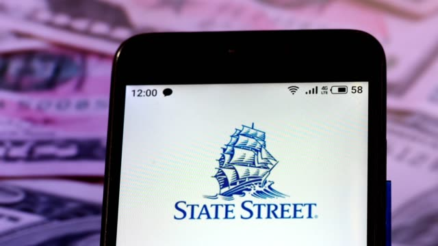 video illustration the logo of state street corporations is displayed on a smartphone rotating at different denominations dollar bills video taken in... - financial accessory stock videos & royalty-free footage