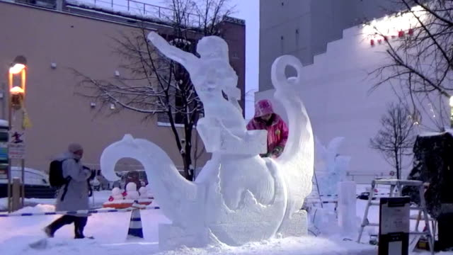 """video image shows participants in """"2016 world ice sculpture competition"""" in japan's northern city of asahikawa creating ice statues. around 70... - asahikawa stock videos & royalty-free footage"""