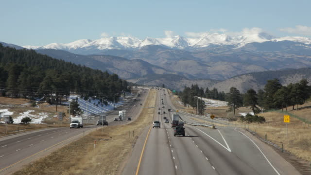 HD video Interstate-70 highway traffic and Rocky Mountains Colorado
