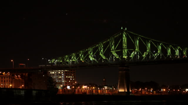 4k video jacques cartier bridge illuminated at night, montreal, quebec - montréal stock videos & royalty-free footage