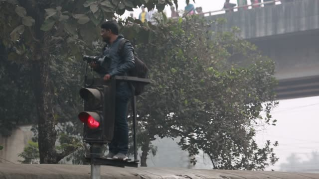 a video journalist taking video from rail line signal covering akheri munajat the final prayers at the world muslim congregation biswa ijtema at... - number of people stock videos & royalty-free footage