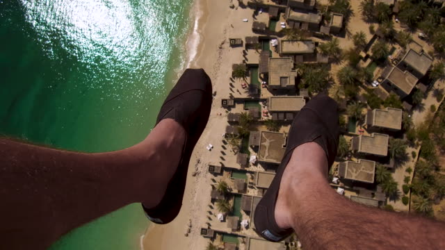video looking down of paraglider's feet in oman, daytime - human leg stock videos & royalty-free footage