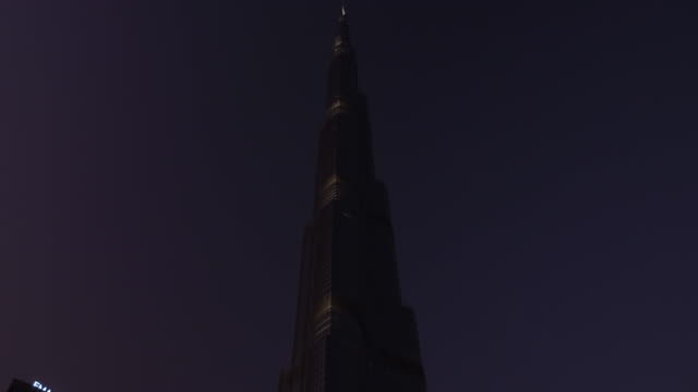 video looking up at the burj khalifa in the evening - burj khalifa stock videos & royalty-free footage