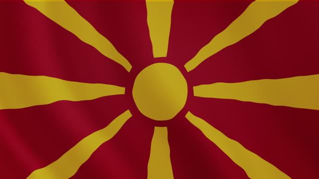 vídeos de stock, filmes e b-roll de vídeos 4 k : macedónia acenando a bandeira - república da macedônia