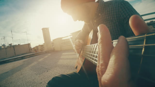 POV video: man playing guitar and singing