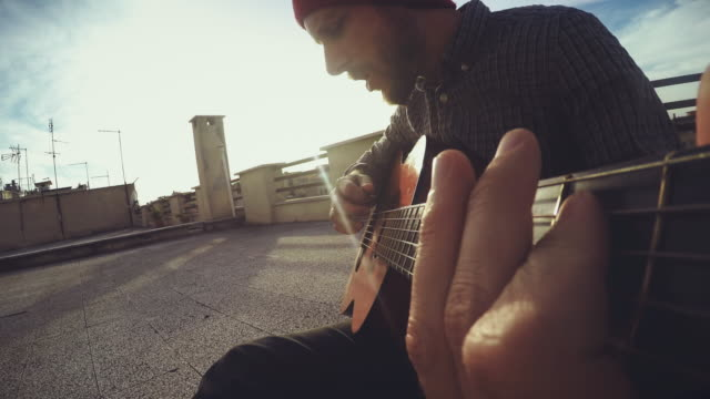 pov video: man playing guitar and singing - musical instrument stock videos & royalty-free footage