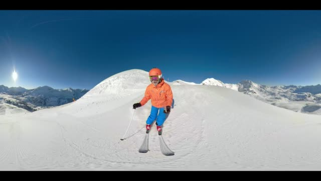 360VR 4K video man skiing on ski slope on sunny day
