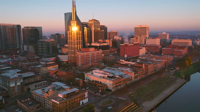 4k video nashville tennessee skyline and cumberland river aerial drone footage during sunrise - south stock videos & royalty-free footage