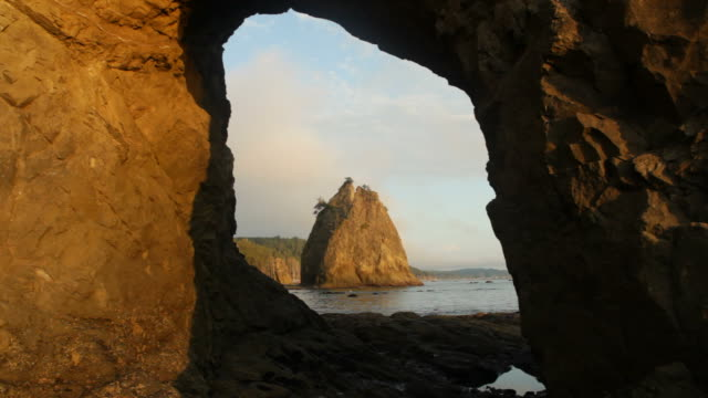 hd video natural arch and sea stacks sunset olympic np - olympic national park stock videos and b-roll footage