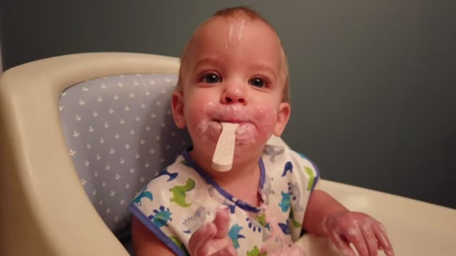 4k video of a baby boy eating yogurt. - messy stock videos & royalty-free footage