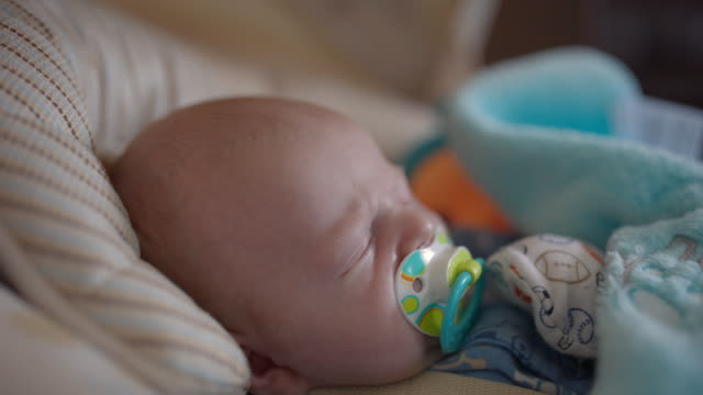 video of a baby sleeping with pacifier - pacifier stock videos and b-roll footage