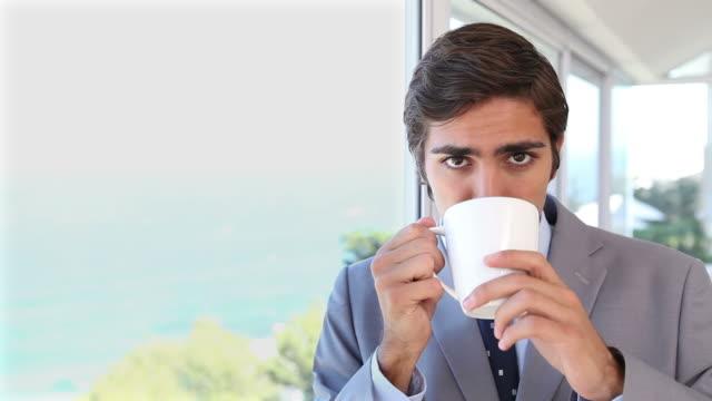Video of a businessman drinking a tea