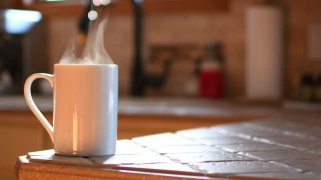 video of a coffee cup in the sunlight. - weekend activities stock videos & royalty-free footage